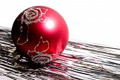 foto of tawdry  - red christmas ball and white shiny spangle - JPG