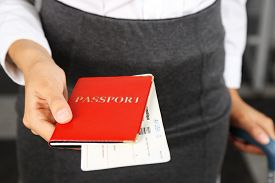 picture of passport cover  - Woman holding passport and tickets close up - JPG