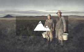 picture of mongolian  - Mongolian Couple Farmers Holding Basin Posing Field Concept - JPG