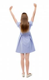 stock photo of waving hands  - Back view of beautiful woman welcomes - JPG