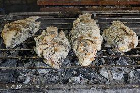 picture of crust  - Closeup Thai Food Salt Crusted Grilled Fish - JPG