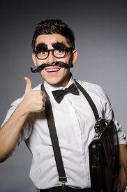 picture of moustache  - Young caucasian man with false moustache against gray - JPG