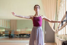 picture of ballet barre  - The classic ballet dancer posing at ballet barre on a rehearsal room background - JPG