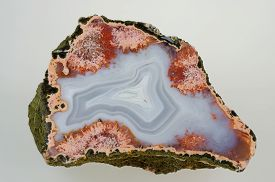 picture of agate  - A cross section of agate stone on a grey background - JPG
