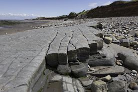 stock photo of shale  - Doniford Bay consists of the Lower Jurassic Lias and Triassic beds - JPG
