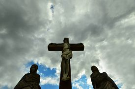 picture of crucifixion  - crucifixion scene against a wide angle dramaticaly clouds - JPG