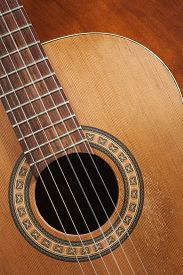 picture of nylons  - Nylon string acoustic guitar detail on wood - JPG
