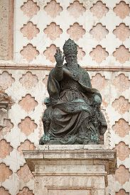stock photo of plinth  - Statue on a plinth outside a building in of the old township of Perugia in the Umbrian region of Italy - JPG