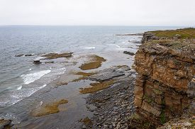 picture of murmansk  - Rocky coast of the Barents Sea on the Rybachy peninsula near Murmansk - JPG