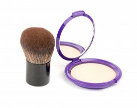 foto of face-powder  - Face powder with kabuki brush on isolated white background - JPG