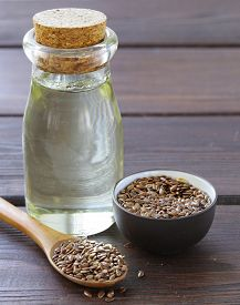 pic of flax seed oil  - flax seed oil in glass bottles on a wooden table