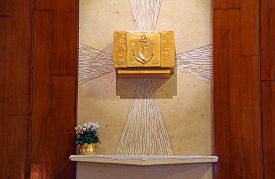 stock photo of tabernacle  - precious ancient Golden Tabernacle with Christian symbols in the Catholic Church - JPG