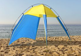 picture of nylons  - Blue and yellow nylon tent at the beach - JPG