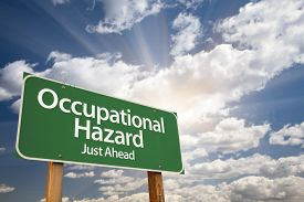 picture of hazardous  - Occupational Hazard Green Road Sign With Dramatic Clouds and Sky - JPG