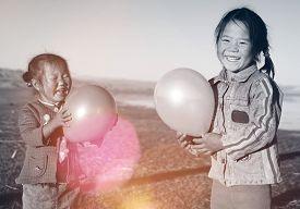 picture of mongolian  - Asian Girls Playing Lake Balloon Rural Mongolian Concept - JPG
