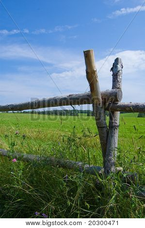 Old style wooden fence surrounding Field in Cavendish, Prince Edward Island