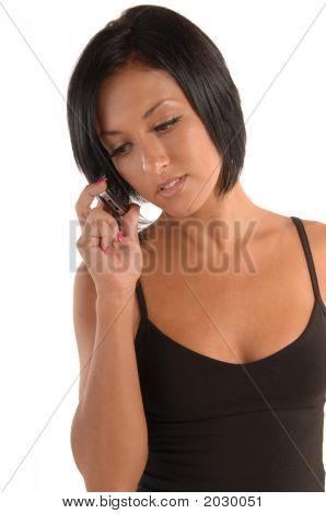Attractive Female In Sports Wear Talking On Cellphone