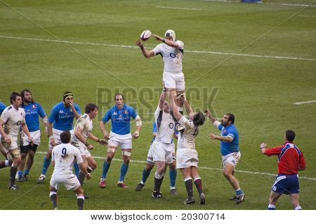 TWICKENHAM LONDON - FEB 12: English Lineout catch at England vs Italy, England playing in white Win 59 -13, at RBS Six Nations Rugby Match on February 12, 2011 in Twickenham, England.