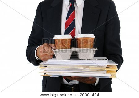 Business man holding a take out tray of disposable coffee cups on top of a stack of files. Closeup in Horizontal format isolated on white showing torso only.