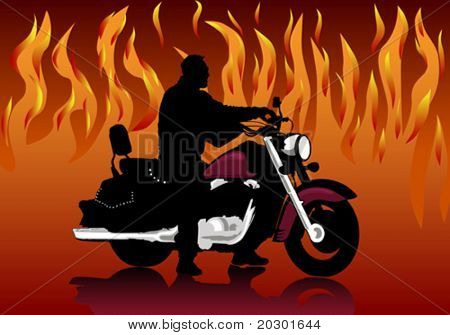 Silhouette of the motorcyclist on a background of fire