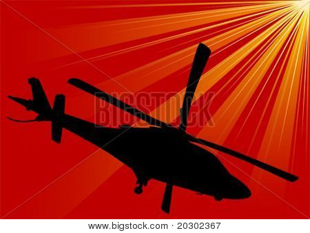 Vector drawing of military helicopters on a background of red sky