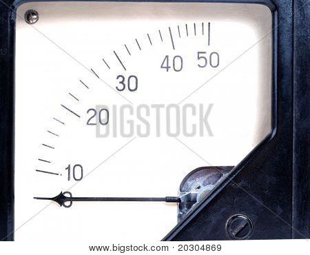Color photo of a old black plastic ammeter