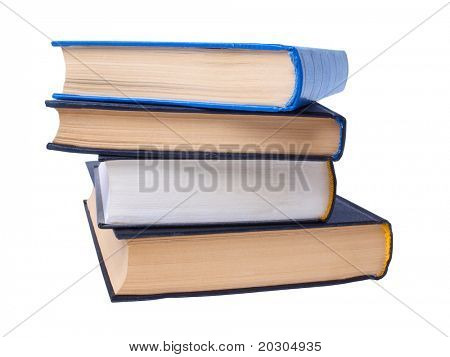 Color photo of a big stack of books on white background