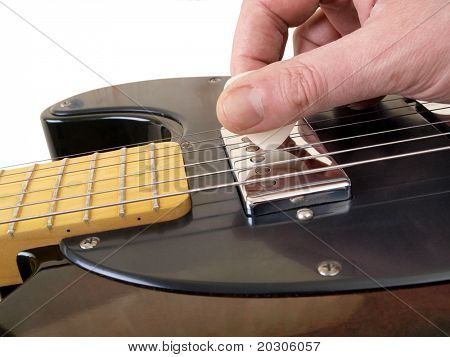 Color photo of electric guitar and pick
