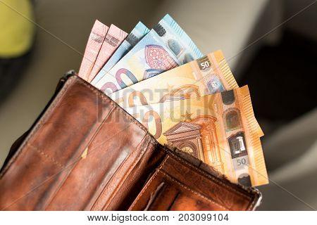 Euro bills in a wallet. Leather wallet.