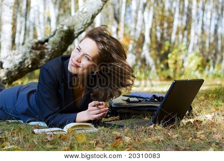 Young businesswoman working on nature.