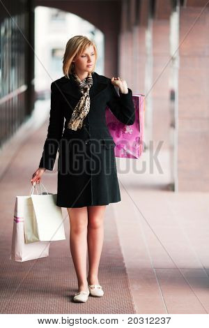Young woman in a shopping arcade.
