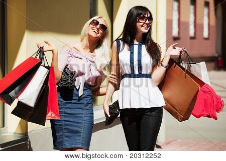 Two happy buyers. Stock Photo & Stock Images | Bigstock