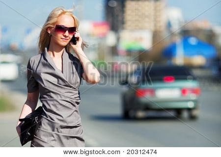 Young businesswoman on the phone.