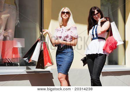 Two young women shopping.