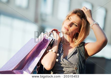 Young shopper against a mall windows