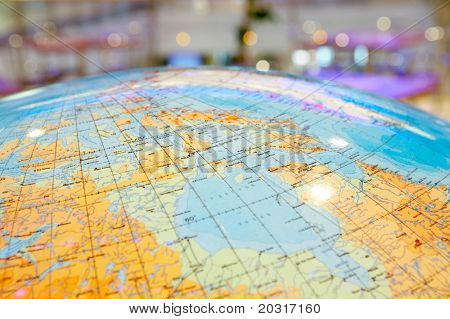 Top of the geographical globe on a dim background