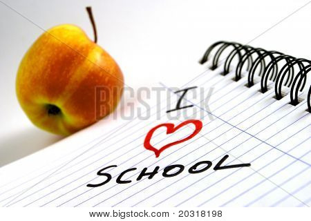 "paper-block with ""i love school"" written on it,apple in the background"