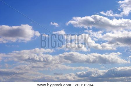 blue skies with fluffy clouds