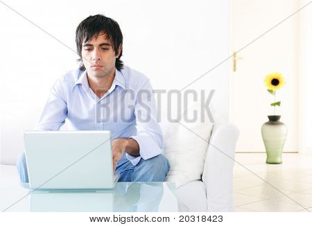 young man home with laptop