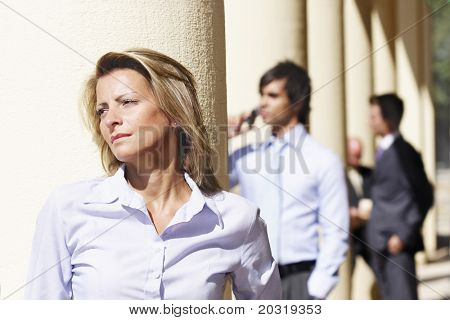 businesswoman gazing, businesspeople in the background