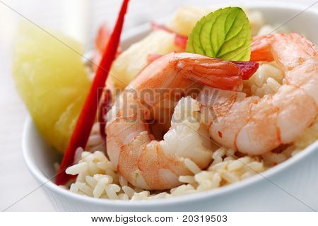 closeup of shrimps with pineapple,red pepper and rice, red curry,coconut and pineapple sauce