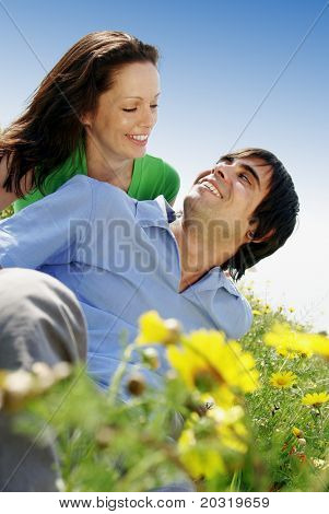 happy couple in flowerfield