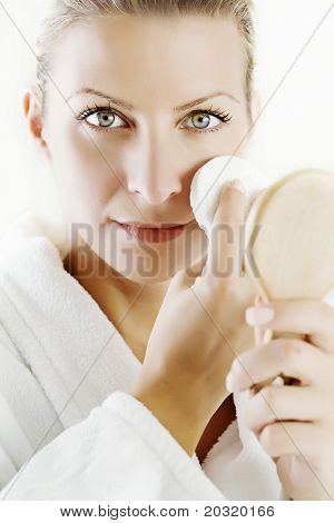 young female cleaning her skin or removing her makeup
