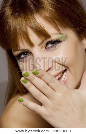 giggling female with bright color makeup