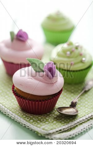 closeup of beautiful summer cupcake with strawberry flavoured cream