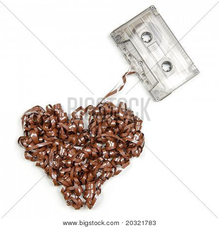Vintage transparent Compact Cassette with pulled out tape in the shape of heart on white background