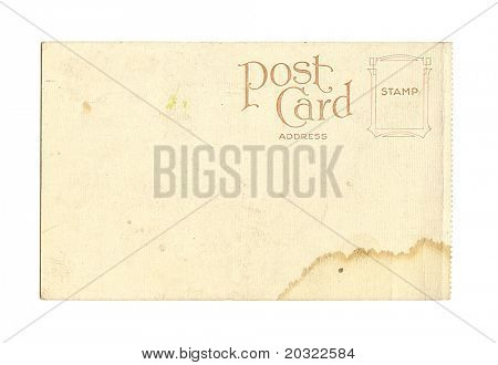 Old stained postcard isolated on a white background.