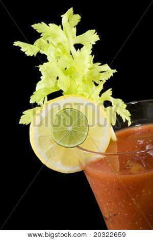 Closeup of a bloody mary cocktail isolated on a black background