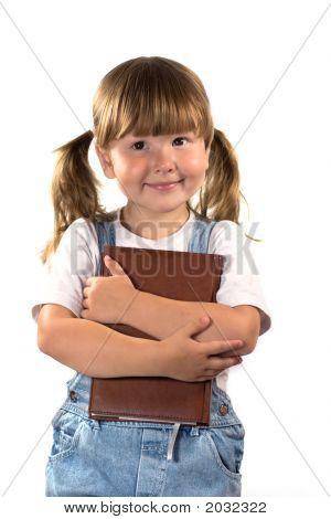 Soñando a niña con libro