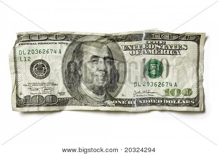 Crumpled hundred dollar bill in United States Currency, isolated on a white background